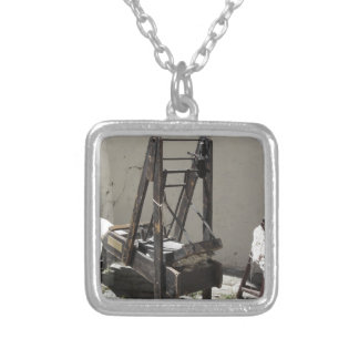 Ancient wool carding machine and raw wool yarn silver plated necklace