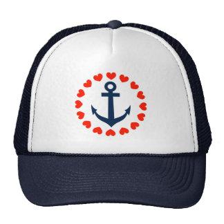 Ancla náutica con el gorra navegante de los corazo