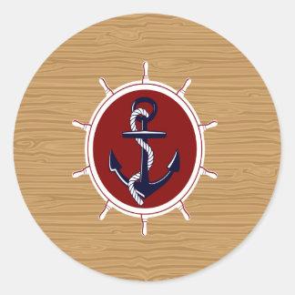 Ancla náutica de las ruedas de las naves en el pegatina redonda