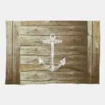 Ancla náutica en el gráfico de madera toallas de mano