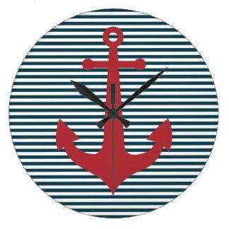 Ancla náutica roja en fondo azul rayado relojes de pared
