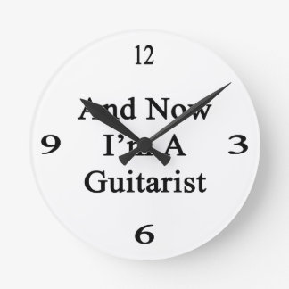 And Now I'm A Guitarist Round Wall Clocks