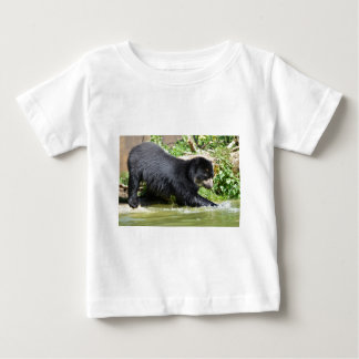 Andean bear in water baby T-Shirt