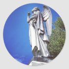 Angel and a bright blue sky classic round sticker