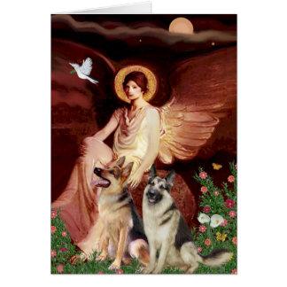 Ángel asentado - dos pastores alemanes tarjeta de felicitación