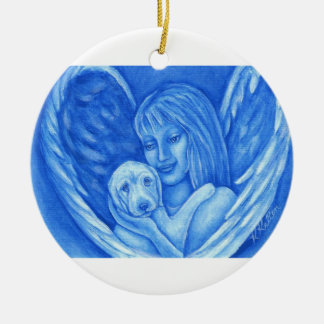 Ángel azul con el ornamento del navidad del perro ornamentos de reyes