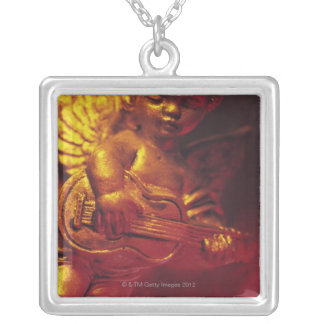 ángel grimpola personalizada