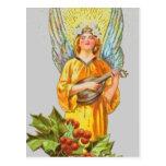 Ángel con acebo y la mandolina tarjetas postales