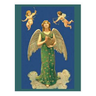 Ángel con el corazón y el Cupid