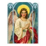 Ángel con el tríptico rosado de la cinta tarjeta postal