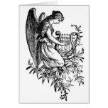 Ángel con la arpa y la flora tarjeta de felicitación