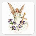 Ángel con la flor de la cruz y del Clematis Calcomania Cuadrada Personalizada