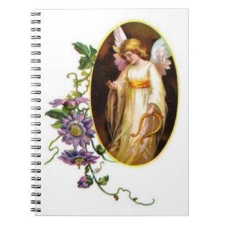 Ángel con las flores de la arpa y del Clematis Libro De Apuntes Con Espiral