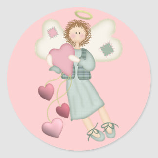 Ángel con los pegatinas de los corazones pegatina redonda