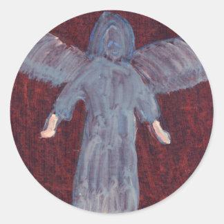 Ángel con los pies grandes pegatina redonda