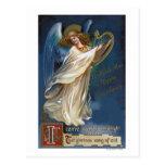 Ángel con una arpa postales