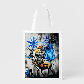 Ángel de la nieve, bolso de ultramarinos bolsas de la compra