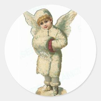 Ángel de la nieve del navidad pegatina redonda
