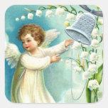 Ángel del bebé con Bell azul Calcomanía Cuadrada