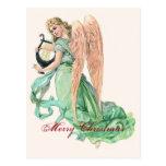 Ángel del navidad con la arpa postal