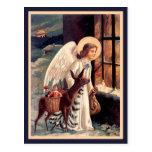 Ángel del navidad con la postal del vintage de los