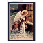 Ángel del navidad con la tarjeta de felicitación d