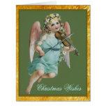 Ángel del navidad con la tarjeta grande del violín
