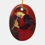 Ángel del navidad con la trompeta adorno navideño ovalado de cerámica