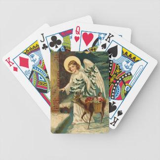 Ángel del navidad del vintage con los ciervos barajas de cartas