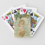 Ángel del navidad del vintage que cuelga de acebo barajas de cartas