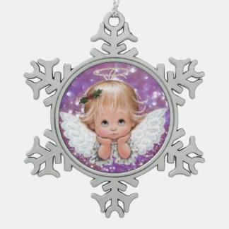 Ángel del navidad en el ornamento del estaño del adorno de peltre en forma de copo de nieve
