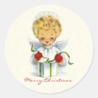 Ángel del navidad que envuelve al pegatina del reg