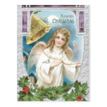 Ángel del navidad que suena una campana tarjeta postal
