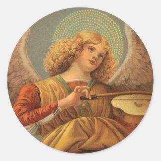 Ángel del navidad que toca el violín Melozzo DA Pegatina Redonda