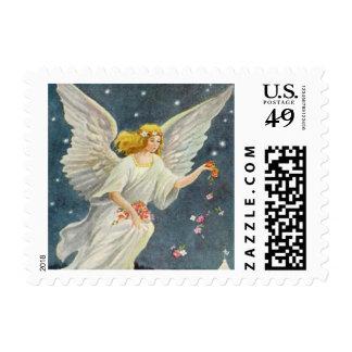 Ángel del Victorian del navidad del vintage con Sello Postal