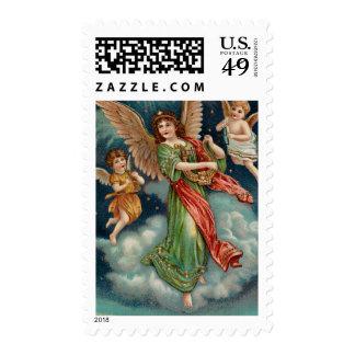 Ángel del vintage con la arpa y dos querubes timbres postales