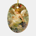 Ángel del vintage y ornamento del día de fiesta de adorno