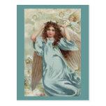 Ángel en guirnalda azul del vestido y de la flor postales