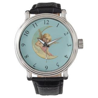 Ángel en una imagen creciente del vintage de la relojes de pulsera