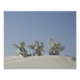 Angel figurines with musical instruments on posters