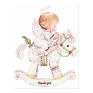 Ángel lindo en un caballo mecedora del navidad postal