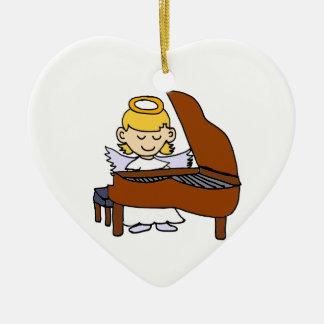 Ángel maravilloso del chica que juega el piano adorno navideño de cerámica en forma de corazón