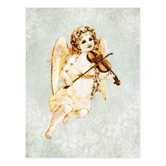 Ángel que toca un violín en fondo del papel del postales