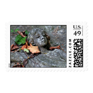 Angel sculpture with autumn leaves stamp