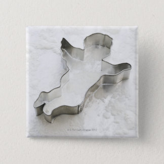 Angel shaped cookie cutter, with flour, close-up pinback button