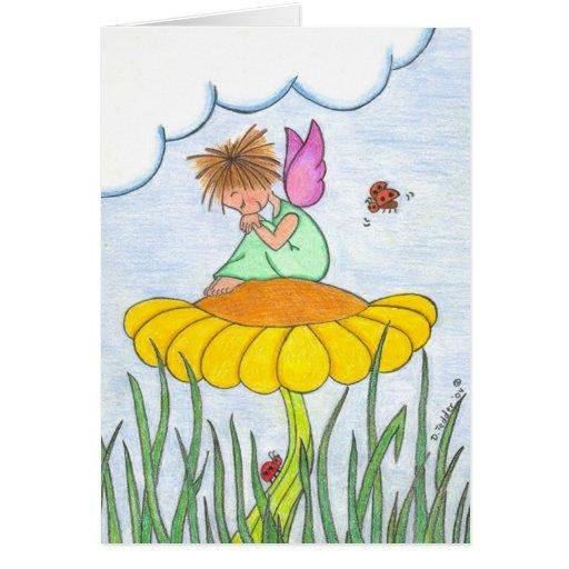 Ángel soñoliento en tarjeta de la flor