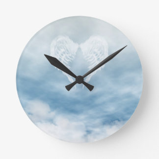 Angel Wings in Cloudy Blue Sky Round Clock