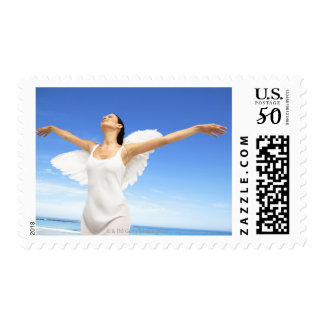 Angel with arms outstretched and eyes closed postage