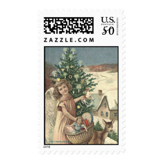 ANGEL WITH BASKET AND TOYS IN SNOW POSTAGE