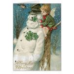 Ángel y muñeco de nieve del navidad tarjeton